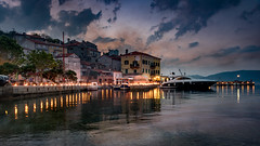 Good Friday in Valun (Bernd Thaller) Tags: valun cres croatia kroatien karfreitag goodfriday village houses buildings outdoor evening sky seaside adria bluehour fire shillyshally dramatic contrast backlight availablelight