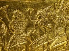 Closeup of gold relief in the interior of King Tutankamun's chariot 18th Dynasty New Kingdom Egypt 1332-1323 BCE (2) (mharrsch) Tags: relief prisoner captive nubian chariot gold transportation pharaoh kingtutankhamun burial tomb funerary 18thdynasty newkingdom egypt 14thcenturybce ancient discoveryofkingtut exhibit newyork mharrsch premierexhibits