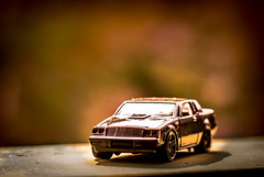 miniature_car_black (Ashique Ridwan) Tags: car outdoor miniature toned toy bangladesh dhaka gorgeous asian red black light sun street macro