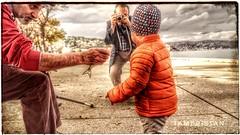 Child, fisherman and photographer with fish. (tameristan) Tags: fish fishing child baby love children kids benalakselarikoglu grandson istanbul bosphorus hdr canon nature bokeh boğaz istanbulboğazı yeniköy fisherman photograph photographer sahil tameristan yaprak leaf leaves rakı sony autumn