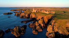 Sunrise at Slains Castle (iancowe) Tags: slain castle slainscastle scotland scottish dracula crudenbay cruden bay peterhead aberdeenshire drone dji phantom 4 pro aerial north sea sunrise cliff cliffs clifftop morning granite pink