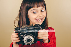 Funny little retro photographer girl (A_S_F) Tags: camera old red portrait people playing cute film girl beautiful female analog vintage mediumformat children fun person photography one kid holding hands funny pretty photographer child looking little expression antique object grain hobby retro equipment nostalgia shooting hispanic brunette nailpolish effect collector oldfashioned takingpictures caucasian filtered instagram