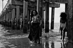 Under the Pier (slightheadache) Tags: nyc newyorkcity party summer people blackandwhite bw newyork beach brooklyn fun coneyisland spring sand coney 2014