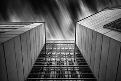 Not Torn (StefanB) Tags: california city longexposure bw motion building glass monochrome architecture clouds san long exposure king martin dr steel library jose sanjose jr geotag 2012 luther 1445mm em5 flvonmirikr