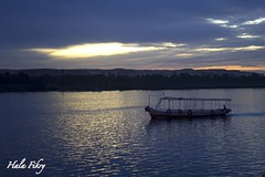Sunsetting boat (halafikry) Tags: sunset reflection clouds river flow boat egypt nile aswan