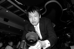 merciless lens attack (troutfactory) Tags: party blackandwhite bw monochrome japan flash   osaka weddingparty kansai hardrockcafe   ricohgrd2