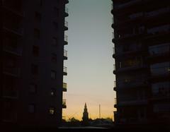 In Between (Bas Tempelman) Tags: silhouette evening flat balcony flats groningen silhouet martinitoren halflight