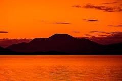 Ben Lomond Bathed in Gold (Brian Travelling) Tags: sunset sky water gold volcano golden scotland benlomond balloch lochlomond duckbay pentaxkr brianmcdiarmid