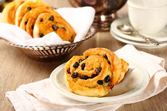 Fresh gluten free sweet swirl buns with raisins (Iryna Melnyk) Tags: life morning food white hot cooking kitchen yellow closeup breakfast french bread table dessert cuisine hotel baking still stuffed healthy rice sweet dough fat wheat traditional group culture free lifestyle tasty fresh gourmet delicious eat domestic homemade bakery snack meal pastry roll swirl organic diet flour yeast bake bun raisin brioche millet baked currants gluten refreshment celiac intolerance