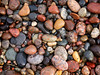 Crisp Point Beach Stones (daveumich) Tags: lighthouse michigan upperpeninsula lakesuperior crisppointlighthouse
