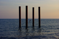 I I I I (Ulrico Hoepli) Tags: sunset sea man evening brighton surfboard rowing oldpier