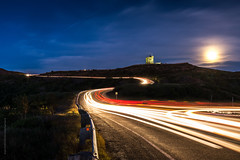 full moon night and light trails on Signal Hill, St. John's (tuanla