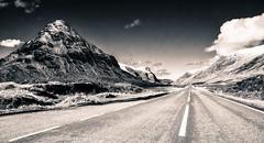 Glencoe (Thousands of Jackdaws) Tags: road mountains monochrome scotland glencoe vanishing d300