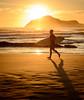The Golden Surfer (ajecaldwell11) Tags: surf beach tide newzealand sand waimarama sunrise surfer dawn sky clouds water hawkesbay bareisland light