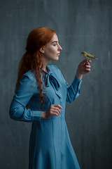 Quiet conversation (gsvoow) Tags: woman bird bluedress
