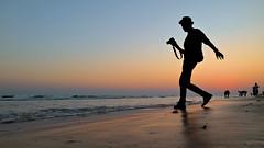 Photographer at Sunset (pallab seth) Tags: silhouette photographer candid odisha puri bayofbengal india sunset samsungnx300m samsung16mmf24ifunctionlens orissa 2016