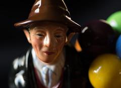 The Balloon Man (f8shutterbug) Tags: idb macromondays glaze macro china porcelain doll figurine colours face balloonman