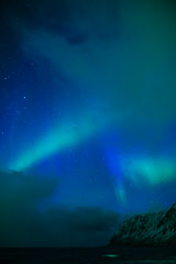 Amazing and Unique Nothern Lights Aurora Borealis Over Lofoten Islands in Norway, Over the Polar Circle. (DmitryMorgan) Tags: norway arc astro astronomy auroraborealis beautiful cold colors famous fjord geomagnetic green illuminated intense ionosphere light lights lofoten luminosity magneticfield mysterious mystery nature night northern northernlights picturesque polarcircle sky solar spring stars sunactivity traveldestination unique vibrant vivid