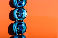 orange and blue - Macro Mondays (retniwave) Tags: macromondays orange blue macro bracelet detail shadows contrast colour