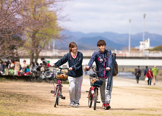 Happy athlete couple dating at bank of Kamo river, Kyoto