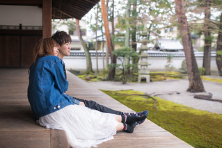 Young couple leaning each other in front of Japanese garden