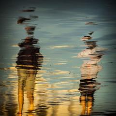 Reflection3 (hassner) Tags: ocean africa sea people abstract reflection strand reflections southafrica pedestrian cape westerncape valsebay