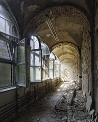 One brick at a time (Subversive Photography) Tags: light sun brick art abandoned window architecture germany dark rust ruins arch decay perspective corridor atmosphere health german urbanexploration rays sanatorium derelict urbex lung sanitorium ruinsofmodernity danielbarter