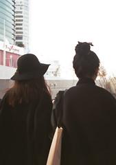 Hat & Bun (common sayings) Tags: plaza travel black film hat fashion 35mm hair design asia fuji south korea seoul frame trendy half hip fujica bun dongdaemun fashionable ddp wek