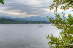 Rowing (ray_anthony) Tags: trees lake mountains water clouds landscape boat nikon scenery branches hills rowing yachts nikkor hdr highdynamicrange lakewindermere windermere photomatix hdrphotography
