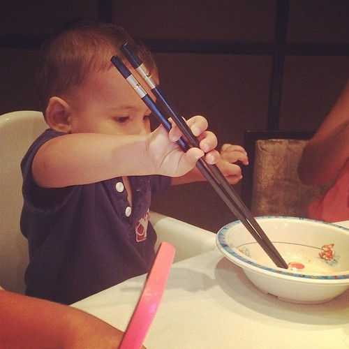 Luca tried chop sticks for the first time #delicious