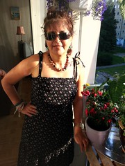 New dress (blondinrikard) Tags: flowers portrait woman sunglasses dress balcony