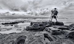 The Landscape Photographer (B&W Version) (El Fotógrafo de Paisajes) [Explored] (Samuel Santiago) Tags: blackandwhite beach interesting flickr florida marineland fineartphotography coquina outcrops canonef1740mmf4l palmcoast explored landscapephotographer canon5dmkii carloscintron lightroom5 topazbweffects sammysantiago