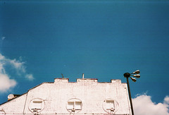 city horizons #2 (joanna.kf) Tags: sky cloud white building architecture clouds contrast colours streetlamp lookingup warsaw canonet expiredfilm whitebuilding canonetql19