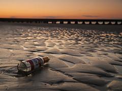 The dawn after a night of revelry (Riccardo Palazzani) Tags: italy beach sunrise dawn bottle alba olympus national alcool di spiaggia geographic lido riccardo revelry pontile veneto jesolo bottiglia bagordi baldoria palazzani veridiano3