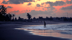ALONE (CUMBUGO) Tags: ocean sunset red brazil people cloud sun sunlight man reflection beach water brasil strand america evening sand nikon surf sundown south fortaleza nikkor f28 d800 70200mm d800e