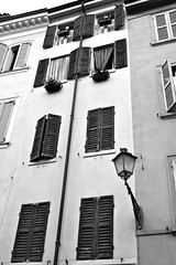 Italian windows (windysmiles) Tags: street old city travel italien windows urban blackandwhite bw italy building muro window vertical wall architecture facade grey nice italian ancient strada italia grigio village fenster traditional edificio traditions emilia finestra lamplight tradition typical modena antico viaggio architettura biancoenero lampione verticale citt emiliaromagna greyscale italiano steady finestre lowsaturation paese tradizionale facciata persiane tradizioni lowsat scaladigrigi