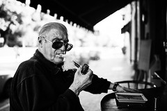 Life is a movie (Giulio Magnifico) Tags: life lighting city boss light inspiration man black reflection eye thread sunglasses composition contrast vintage dark movie relax interesting intense eyes shadows power emotion expression live character pipe citylife thoughtful streetphotography streetportrait style smoking sharp thoughts elder catch essence smoker gaze glance glacial udine doisneau nikond800e sigma35mmf14dghsm