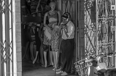 Shop Keeper (FleetingEye) Tags: street city travel portrait people blackandwhite bw man men peru southamerica cityscape scenic international iquitos streetscape 2012