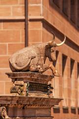 a bull statue at Fleischbrucke (Smiley Man with a Hat) Tags: bridge germany deutschland bavaria spring nuremberg altstadt nurnberg brucke 2014 pegnitz hauptmarkt fleischbrucke fleischbridge