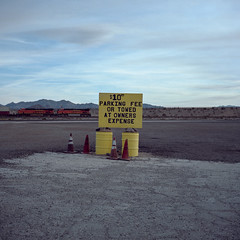 the world is your parking lot. fenner, ca. 2016. (eyetwist) Tags: eyetwistkevinballuff eyetwist route66 10 parking towed empty lot fenner california mojavedesert roadsideamerica i40 interstate gasstation gasoline mamiya 6mf 50mm kodak portra 160 mamiya6mf mamiya50mmf4l kodakportra160 ishootfilm ishootkodak analog analogue film emulsion mamiya6 square 6x6 mediumformat 120 filmexif iconla epsonv750pro 6 mojave desert highdesert landscape motherroad us66 route 66 sign type signage typography typographic gas american west dusk barstow needles essex goffs hisaharaoasis expensivegas yellow bnsf santafe train locomotive gouge handpainted towedatownersexpense typology bleak decay