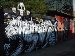 Chad and the tiger (C_Oliver) Tags: england london e1 shoreditch spitalfields graffiti streetart tiger whitetiger chad kilroy kilroywashere statue sculpture bricks brickwall mural shoreditchhighstreet fleurdelisstreet