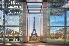 The Wall for Peace and Eiffel Tower (Dmitry Yelloff) Tags: france paris europe european city town urban streets buildings architecture exterior outdoor cityscape capital center monument landmark showplace travel tourism spring eiffel tower day sky clouds sunlight design style retro old big large great high postcard color romantic attraction iron metal history lenght majestic wonder thewallforpeace people symbol lawn trees glass ngc explore trending new