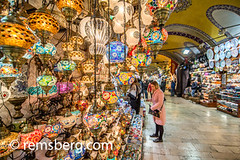 A woman looking at beautiful handmade lanterns for sale at the Grand Bazaar in Istanbul, Turkey, one of the country's most visited landmarks and oldest public markets. (Remsberg Photos) Tags: istanbul turkey grandbazaar bazaar shopping commerce covered goods forsale light lantern selection abundance colorful detail intricate browse choose buy tur