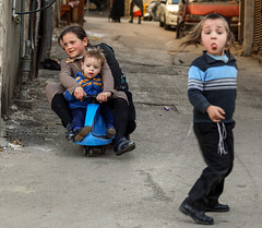 """J.P. Sartre: """"Hell is other people"""". Why Be: """"Hell is to decide what to post, and what not to post"""" (ybiberman) Tags: israel jerusalem meahshearim ultraorthodox jews children playing bimbacar tricycle tongueout tongue payot tzitzit candid streetphotography"""