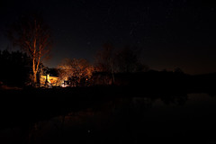 Campfire by the pond (clé manuel) Tags: reflection campfire bonfire fire lagerfeuer water pond lake see weiher teich sterne sky stars sternenhimmel starry samyang 12mm f2 sonyalpha sony alpha a6000 6000 night nacht spiegelung wasser wolkenloser feuer