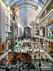 Eaton Centre, Toronto, Ontario (duaneschermerhorn) Tags: shopping mall shoppingmall architecture architect building shops shop structure glassroof arches arch levels bright sky blue people busy