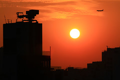 Sunset over busy city (C. Alice) Tags: 2017 airplane sun sunset light sky orange cloud city canonef70200mmf4lisusm canoneos7d spring canon