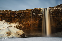 Seljalandsfoss in a Red Glow (wilbias) Tags: red sunset winter water orange evening waterfall long exposure cliff march waterfalls iceland seljalandsfoss