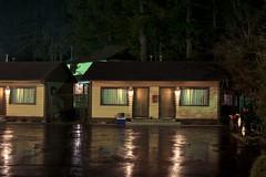 The Dogwood Motel (Curtis Gregory Perry) Tags: dogwood motel oregon idleyld park night longexposure lodging cabin parking lot wet raining reflection puddle water nikon d810 50mm f12