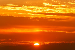 the eye of perdition (TonyD.2) Tags: sun orange morning sunrise 75300mm symmetry clouds warm warmcolor warmcolors colorful colors color colorfull cool